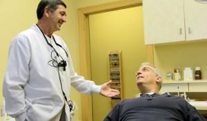 Dr. Phil Gallagher, D.D.S. talking with patient